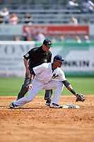 New York Yankees second baseman Starlin Castro (14) looks to tag a baserunner as umpire Vic Carapazza looks on during a Spring Training game against the Detroit Tigers on March 2, 2016 at George M. Steinbrenner Field in Tampa, Florida.  New York defeated Detroit 10-9.  (Mike Janes/Four Seam Images)