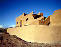 ADOBE ARCHITECTURE<br /> Modern Home, New Mexico<br /> Adobe, a cheap insulator, used in modern architecture as a passive solar collector. The sun's heat travels through the adobe slow enough to reach the interior as night falls, heating the house through the night