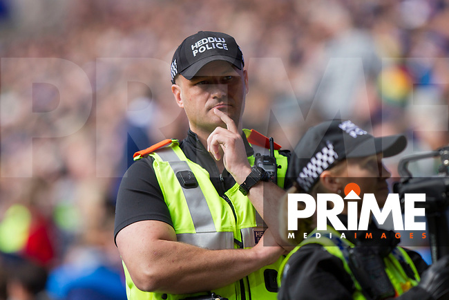 Police monitor the away fans during the Sky Bet Championship match between Cardiff City and Sheffield Wednesday at Cardiff City Stadium, Cardiff, Wales on 16 September 2017. Photo by Mark  Hawkins / PRiME Media Images.