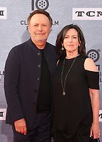 """Los Angeles CA Apr 11: Billy Crystal, Janice Crystal, arrive to 2019 TCM Classic Film Festival Opening Night Gala And 30th Anniversary Screening Of """"When Harry Met Sally"""", TCL Chinese Theatre, Los Angeles, USA on April 11, 2019 <br /> CAP/MPI/FS<br /> ©FS/MPI/Capital Pictures"""