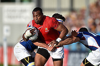 David Halaifonua of Tonga takes on the Namibia defence. Rugby World Cup Pool C match between Tonga and Namibia on September 29, 2015 at Sandy Park in Exeter, England. Photo by: Patrick Khachfe / Onside Images