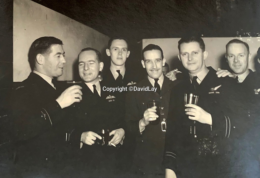 BNPS.co.uk (01202 558833)<br /> Pic:  DavidLay/BNPS<br /> <br /> Letting their hair down in the Officers Mess.<br /> <br /> Bomber command heroes WW2 exploits discovered in a shoebox.<br /> <br /> The personal effects of a fearless 'Tail-end Charlie' have been discovered in a shoebox - and they include a charming set of photos of his wartime service.<br /> <br /> Flight Sergeant Douglas Alexander, of 460 Squadron, took part in nearly 40 bombing raids over Germany, including the famous assault on Hitler's mountain retreat, Berchtesgaden.<br /> <br /> As a tail gunner, he sat in a tiny glass turret at the rear of Lancaster and Halifax bombers - a terribly exposed position.<br /> <br /> The shoebox, containing his bravery medals, logbooks and photos, was bought into auctioneer David Lay Frics, of Penzance, Cornwall, by his daughter.<br /> <br /> Flt Sgt Alexander's medal group includes the prestigious Distinguished Flying Medal, awarded for 'exceptional valour, courage and devotion to duty', with his photos capturing the camarederie which existed in the RAF as the airmen risked their lives on every mission to defeat Adolf Hitler.