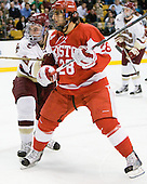Edwin Shea (BC - 8), Sahir Gill (BU - 28) - The Boston College Eagles defeated the Boston University Terriers 3-2 (OT) in their Beanpot opener on Monday, February 7, 2011, at TD Garden in Boston, Massachusetts.