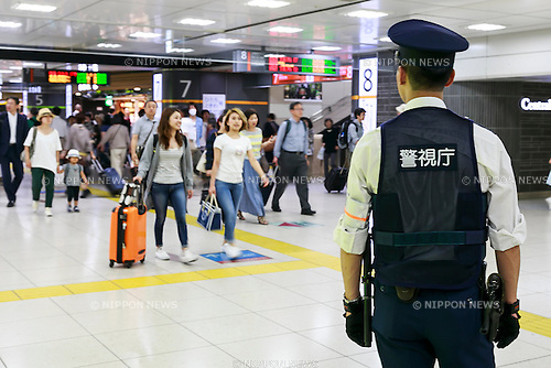 A police officer patrols Tokyo Station on May 23, 2016, Tokyo, Japan. Tokyo Metropolitan Police Department has introduced extra security measures ahead of the two-day G-7 leaders summit to be held in Ise-Shima, in Mie Prefecture in Western Japan from May 26. Train and subway stations have also closed their trash cans and added warning signs in their stations. Meanwhile Mie Prefectural Police began restricting entry to Kashikojima Island and the summit area. (Photo by Rodrigo Reyes Marin/AFLO)