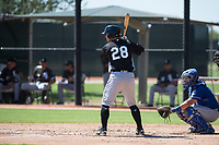 Chicago White Sox catcher Nate Nolan (28) at bat in front of catcher Chase Vallot (3) during an Instructional League game against the Kansas City Royals at Camelback Ranch on September 25, 2018 in Glendale, Arizona. (Zachary Lucy/Four Seam Images)