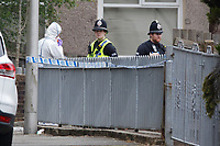 Police and forensics officers at the scene in Brithweunydd Road<br /> Re: A woman has been arrested after a child was found dead at a property in Trealaw, Rhondda, Wales, UK.<br /> The woman, aged 37, was detained when emergency services were called to an address in the town at about 10.20am on Friday.<br /> The death is being treated as unexplained.<br /> As part of the investigation, the main route through Trealaw, Brithweunydd Road, has been closed off.