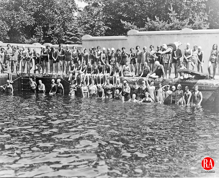 Swimmers at Chase Park are shown here in this 1930 photograph. The woman diving, in mid air, is Peg Sugdinis.