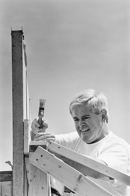 "Speaker of the House Rep. Newton Leroy ""Newt"" Gingrich, R-Ga., hammers a nails into the house frame he's working on for Habit for Humanity. June 5, 1997 (Photo by Maureen Keating/CQ Roll Call)"