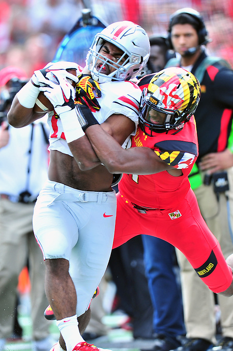 Buckeyes' Ezekiel Elliot gain big yards against the Terrapins. Ohio State trounced Maryland 52-24 during a game at the Capital One Field in Byrd Stadium, College Park, MD on Saturday, October 3, 2014.  Alan P. Santos/DC Sports Box