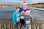 Niamh, Karen and Ruarui Condon from Tralee at the Santa Fun run in memory of Fiona Moore, in the Tralee Bay Wetlands on Sunday.
