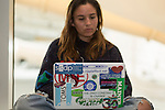 Julia and her laptop at Powershift in Pittsburgh, PA. USA. (Photo by: Robert van Waarden)