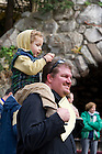 "Nov. 2, 2012; Spectators watch students read from The Divine Comedy during the conclusion of ""Donte Now"" at the Grotto. Italian Studies at Notre Dame and the College of Arts and Letters' and the William and Katherine Devers Program in Dante Studies hosted ""Dante Now"" at various locations around campus. Photo by Barbara Johnston/University of Notre Dame"