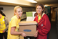Faithe Russell,'20, and Ashley Sabia,'20, move boxes of magazines to a storage area at the Redwood Library in Newport as they take part in Salve's Exploration Day of Service