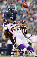 Seattle Seahawks quarterback Tarvaris Jackson (7) is tackled by Minnesota Vikings defensive end Adrian Awasom (67) in the first half of the game at CenturyLink Field in Seattle, Washington. The pass was incomplete.
