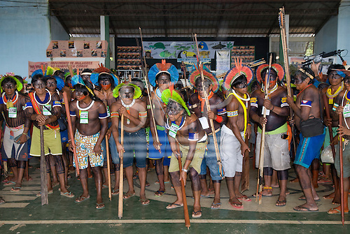 Altamira, Brazil. Encontro Xingu protest meeting about the proposed Belo Monte hydroeletric dam and other dams on the Xingu river and its tributaries. Kayapo chiefs and warriors adopt a warlike pose.