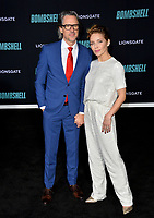 "LOS ANGELES, USA. December 11, 2019: Charles Randolph & Mili Avital at the premiere of ""Bombshell"" at the Regency Village Theatre.<br /> Picture: Paul Smith/Featureflash"