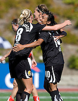 Marta of Gold Pride celebrates with teammates after scoring a goal during the second half of the game against Freedom at Pioneer Stadium in Hayward, California.  Gold Pride defeated Washington Freedom, 3-2.