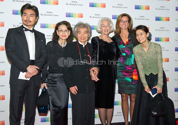 Conductor Seiji Ozawa and guests arrive for the formal Artist's Dinner honoring the recipients of the 38th Annual Kennedy Center Honors hosted by United States Secretary of State John F. Kerry at the U.S. Department of State in Washington, D.C. on Saturday, December 5, 2015. The 2015 honorees are: singer-songwriter Carole King, filmmaker George Lucas, actress and singer Rita Moreno, conductor Seiji Ozawa, and actress and Broadway star Cicely Tyson.<br /> Credit: Ron Sachs / Pool via CNP/MediaPunch