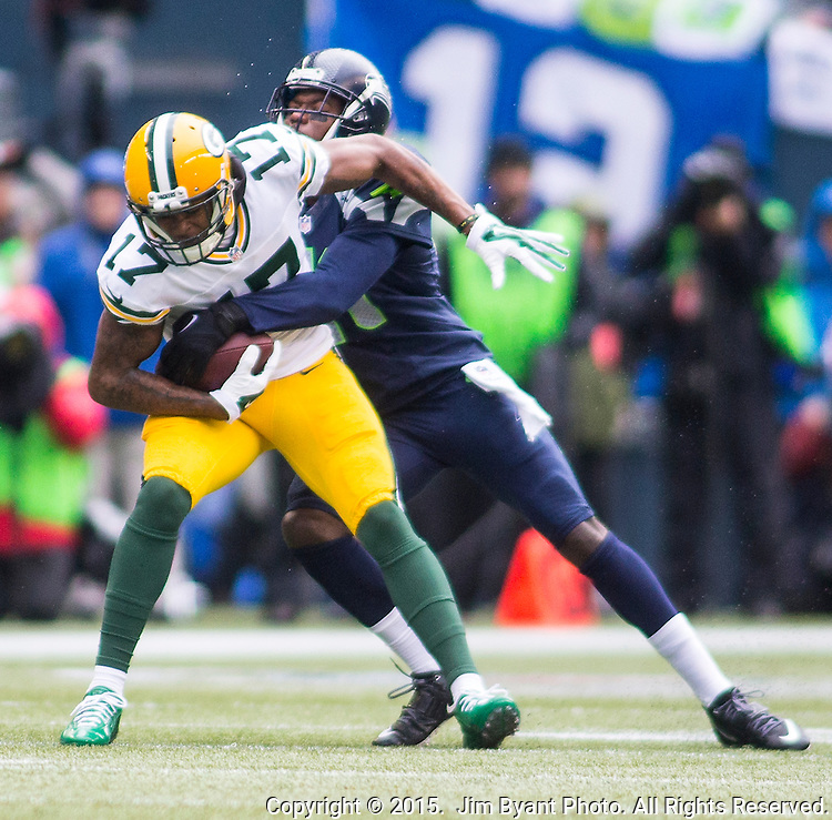 Seattle Seahawks cornerback Byron Maxwell (41) wraps up Green Bay Packers wide receiver Davante Adams (17) for a short gain during the NFC Championship game at CenturyLink Field in Seattle, Washington on January 18, 2015.  The Seattle Seahawks beat the Green Bay Packers in overtime 28-22 for the NFC Championship Seattle.  ©2015. Photo by Jim Bryant, All Rights Reserved.