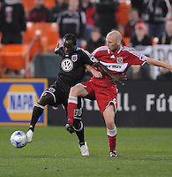 DC United  forward Francis Doe (30)  shields the ball against Chicago Fire defender Tim Ward (5) Chicago Fire tied DC United 1-1 at  RFK Stadium, Saturday March 28, 2009.