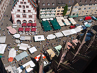 Germany, DEU, Baden-Wurttemberg, Freiburg im Breisgau, 2010Jul29: Market stalls on the Münsterplatz in the old town of Freiburg im Breisgau.