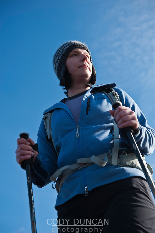 Portrait of female hiker with blue sky in background