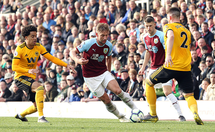 Burnley's Charlie Taylor under pressure from Wolverhampton Wanderers' Helder Costa (left) and Matt Doherty<br /> <br /> Photographer Rich Linley/CameraSport<br /> <br /> The Premier League - Burnley v Wolverhampton Wanderers - Saturday 30th March 2019 - Turf Moor - Burnley<br /> <br /> World Copyright © 2019 CameraSport. All rights reserved. 43 Linden Ave. Countesthorpe. Leicester. England. LE8 5PG - Tel: +44 (0) 116 277 4147 - admin@camerasport.com - www.camerasport.com