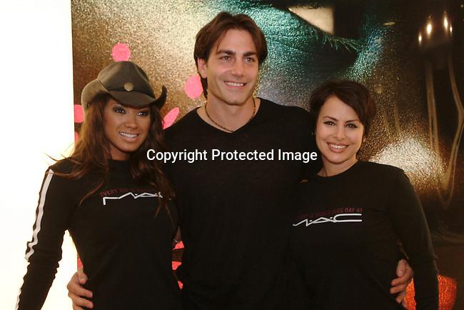 Traci Bingham,  Michael Bergin &amp; Natalie Raitano<br />MAC AIDS Fund and Viva Glam on World Aids Day<br />MAC Store<br />Hollywood, CA, USA<br />December 1, 2003 <br />Photo By Celebrityvibe.com /Photovibe.com