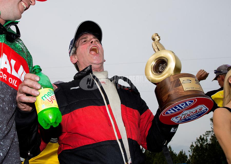 Mar 16, 2014; Gainesville, FL, USA; NHRA top alcohol funny car driver Dan Pomponio celebrates after winning the Gatornationals at Gainesville Raceway Mandatory Credit: Mark J. Rebilas-USA TODAY Sports