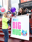 Laura Heywood, aka @BroadwayGirlNYC, with fellow huggers attends Big Hug Day: Broadway comes together to spread kindness and raise funds for Children's Hospitals on January 21, 2018 at Duffy Square, Times Square in New York City.