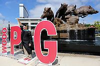 NWA Democrat-Gazette/DAVID GOTTSCHALK Rob Stagni, who is receiving his doctorate in Higher Education from the University of Arkansas, poses Friday, May 10, 2019, as the I in the word PIG while standing in front of the Wild Band of Razorbacks monument on the northeast corner of Donald W. Reynolds Razorback Stadium on the campus in Fayetteville. The Razorback Foundation and the Athletic Department had a photographer at the fountain available to graduating students to have their photographs shot for free.