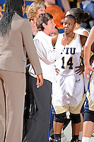 12 January 2012:  FIU Basketball Head Coach Cindy Russo speaks with her players during a break in the action in the first half as the Middle Tennessee State University Blue Raiders defeated the FIU Golden Panthers, 74-60, at the U.S. Century Bank Arena in Miami, Florida.