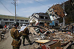 March 28, 2011, Ishonomaki, Japan - Soldiers of Japan Ground Self-Defense Force clear away debris and destroyed houses as reconstruction efforts have started in Ishinomaki, Miyagi prefecture, on Monday, March 28, 2011. Ishinomaki, an industrial port some 350km northeast of Tokyo, is one of the hardest-hit areas in northeast Japan by the March 11 magnitude 9.0 earthquake and the subsequent 10-meter tsunami. Much of the town still remains submerged in muddy waters, which have hampered the efforts of people searching for missing kin and reconstruction. (Photo by AFLO) [3609] -mis-