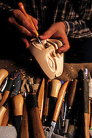 Detail of a traditional Native Alaskan mask being carved. Alaska.