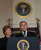 "United States President George W. Bush, accompanied by first lady Laura Bush, makes a statement on the death of Pope John Paul II at the White House in Washington, D.C. on April 2, 2005.  In his remarks, the President lauded the Pope as ""a 'champion of human freedom"".<br /> Credit: Michael Kleinfeld - Pool via CNP"