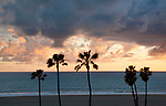 Tropical sunset at Santa Monica beachcaused by presence of rain clouds.
