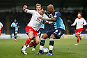 Chris Beardsley of Stevenage takes on Leon Johnson of Wycombe. - Wycombe Wanderers v Stevenage - Adams Park, High Wycombe - 31st December 2011  .© Kevin Coleman 2011