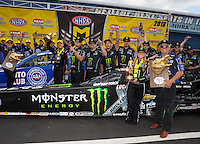Mar 20, 2016; Gainesville, FL, USA; NHRA funny car driver Robert Hight (left) and his crew and top fuel driver Brittany Force and her father John Force celebrate after winning the Gatornationals at Auto Plus Raceway at Gainesville. Mandatory Credit: Mark J. Rebilas-USA TODAY Sports