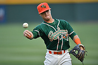 Second baseman Luis Pintor (8) of the Greensboro Grasshoppers warms up before a game against the Greenville Drive on Tuesday, April 25, 2017, at Fluor Field at the West End in Greenville, South Carolina. Greenville won, 5-1. (Tom Priddy/Four Seam Images)