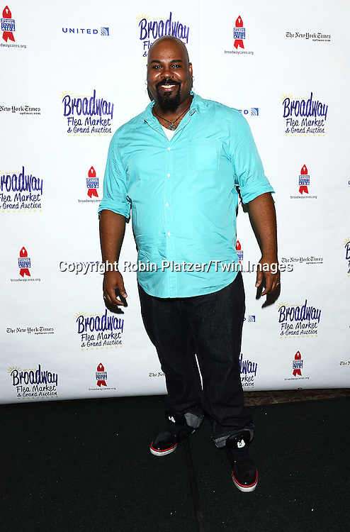 James Monroe Iglehart attends the 28th Annual  Broadway Cares/ Equity Fights Aids Flea Market and Auction on September 21,2014 in Shubert Alley in New York City. <br /> <br /> photo by Robin Platzer/Twin Images<br />  <br /> phone number 212-935-0770