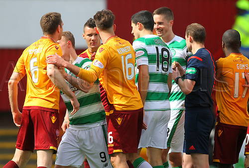 09.04.2016. Fir Park, Motherwell, Scotland. Scottish Football Premiership Motherwell versus Celtic. The referee separates the players as tempers fray in an even match