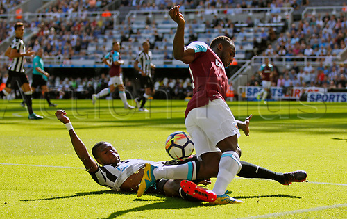 26th August 2017, St James Park, Newcastle, England; EPL Premier League football, Newcastle United versus West Ham United; Chancel Mbemba of Newcastle United tackles Michail Antonio of West Ham United