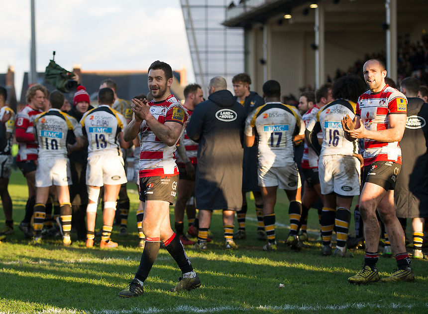 Gloucester Rugby's Greig Laidlaw salutes the crowd after their 13-10 victory over Wasps<br /> <br /> Photographer Ashley Western/CameraSport<br /> <br /> Rugby Union - Aviva Premiership Round 15 - Gloucester Rugby v Wasps - Saturday 5th March 2016 - Kingsholm Stadium - Gloucester<br /> <br /> &copy; CameraSport - 43 Linden Ave. Countesthorpe. Leicester. England. LE8 5PG - Tel: +44 (0) 116 277 4147 - admin@camerasport.com - www.camerasport.com