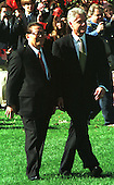 United States President Bill Clinton, right, escorts President Jiang Zemin, right, of China across the White House South Lawn during the Arrival Ceremony for Jiang's State Visit on October 29, 1997..Credit: Ron Sachs / CNP