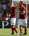 Calcio, Serie A: Roma-Bologna. Roma, stadio Olimpico, 16 settembre 2012..AS Roma midfielder Alessandro Florenzi is hugged by captain Francesco Totti, right, after scoring during the Italian Serie A football match between AS Roma and Bologna, at Rome, Olympic stadium, 16 September 2012. .UPDATE IMAGES PRESS/Isabella Bonotto
