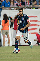 FOXBOROUGH, MA - JULY 27:  Carles Gil #22 advances down the field at Gillette Stadium on July 27, 2019 in Foxborough, Massachusetts.
