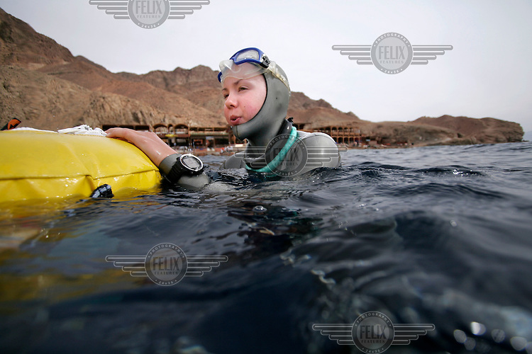 "Freediver Elisabeth Kristoffersen (Norway) breathes before a dive. Freediving competition ""Bizzy Blue Hole"" in Dahab,Sinai in Egypt."