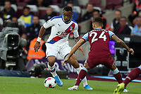 Ryan Fredericks of West Ham United and Jordan Ayew of Crystal Palace during West Ham United vs Crystal Palace, Premier League Football at The London Stadium on 5th October 2019