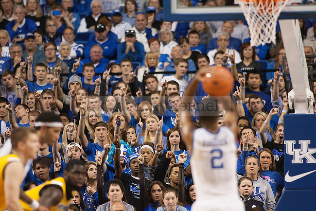 UK fans watch as guard Aaron Harrison takes a free throw during the second half of the UK vs. NKU men's basketball game at Rupp Arena in Lexington, Ky., on Sunday, November 10, 2013. UK defeated NKU 93-63 to move to 2-0 on the year. Photo by Michael Reaves | Staff