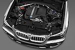 High angle engine detail of a 2011 BMW x3 xDrive35i SUV